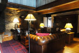 Interior of the Priory showing beams and stonework inn the comfortable lounge area